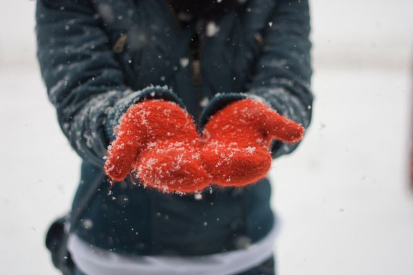 Catching snowflakes with mittens on