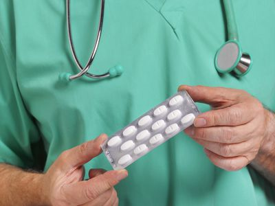 Doctor offering medications to patient