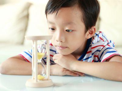 Boy watching an hourglass
