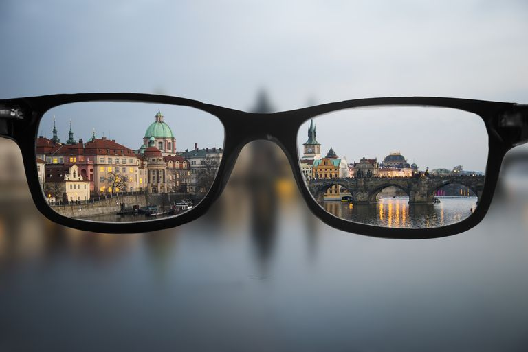 view of a city through eyeglass lenses