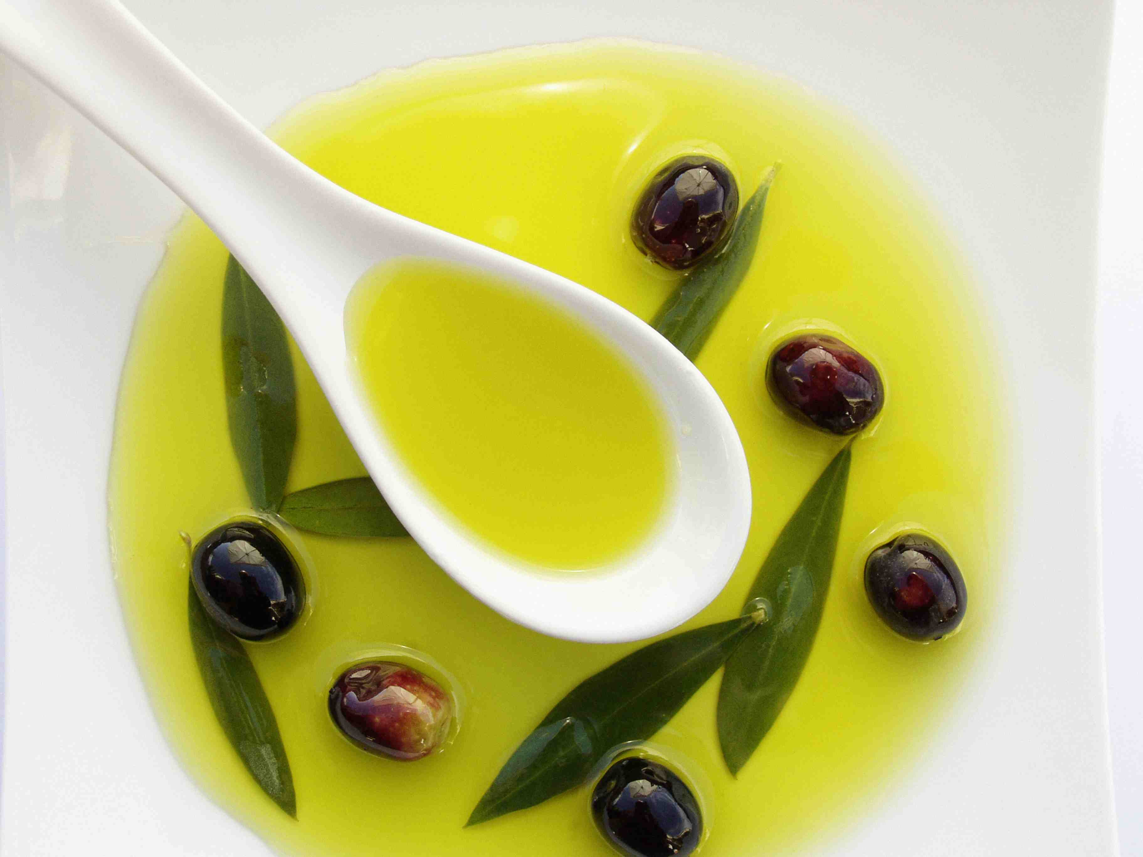 bowl of olive oil with olives