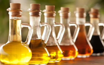Olive oil and vinegar in bottles on a table