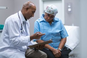 male doctor talking to female cancer patient