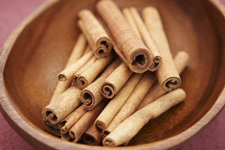 Cinnamon sticks in wooden bowl