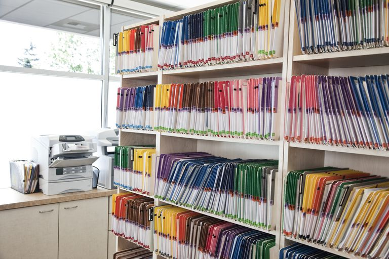 A group of colourful file folders in a dental office.
