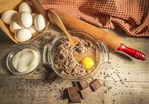 Cracked egg in baking batter