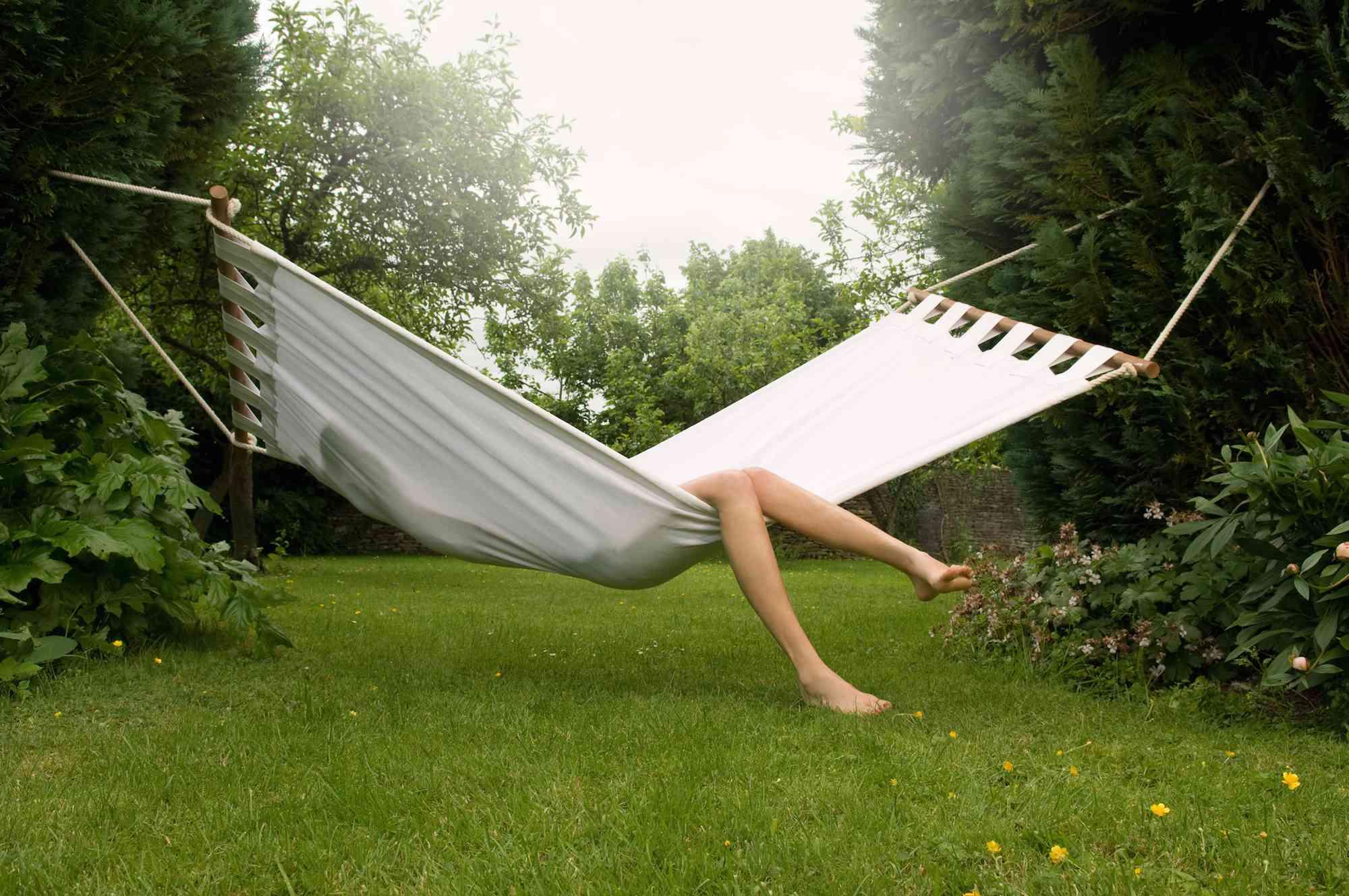 A woman sitting in a hammock