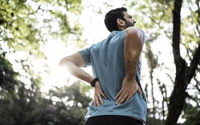 Sportsman feeling backache at a park