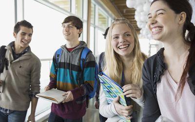 adolescent students in school hallway