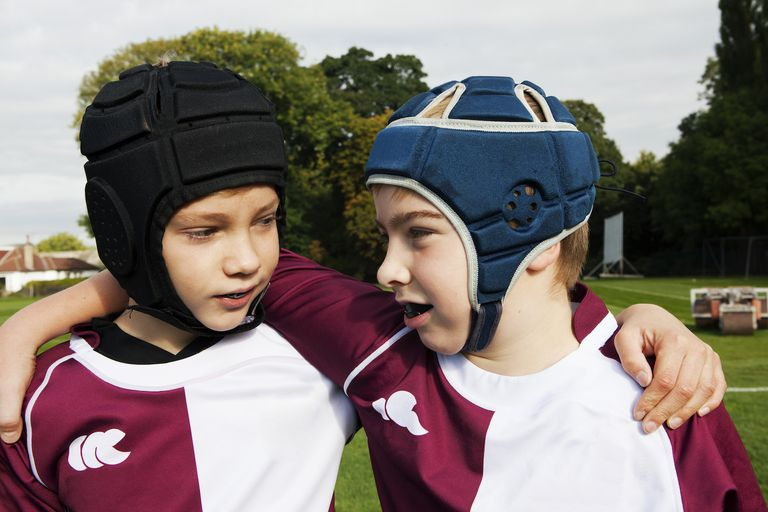 Schoolboys wearing protective headgear