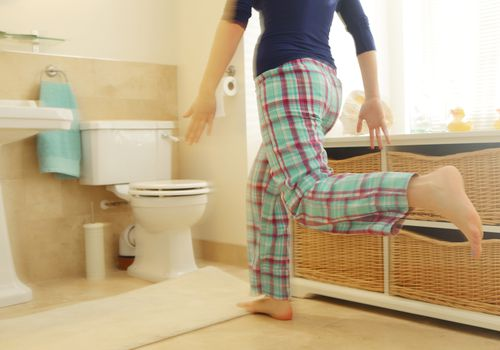 woman running to toilet