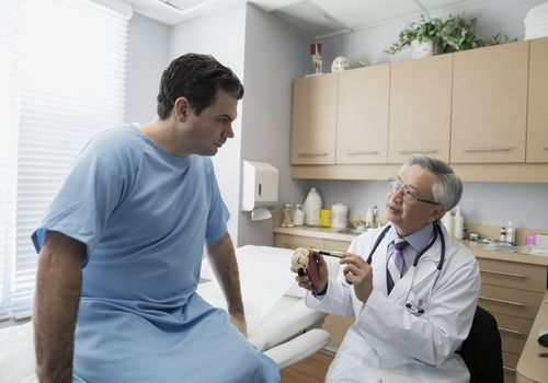 Doctor explaining carcinoma in situ to a patient