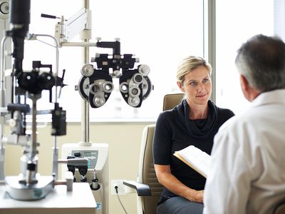 woman talking to eye doctor