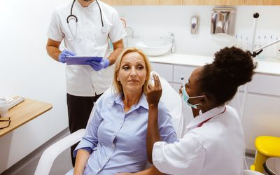 Consulting with plastic surgeon about facial plastic surgery