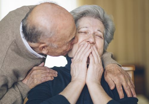 Senior couple kissing and laughing