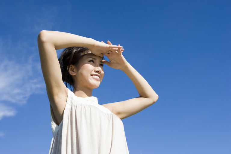 A woman shielding her eyes from the sun