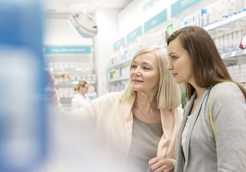 Two women shopping at the pharmacy
