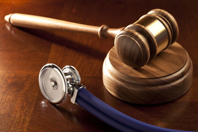 gavel and stethoscope on table