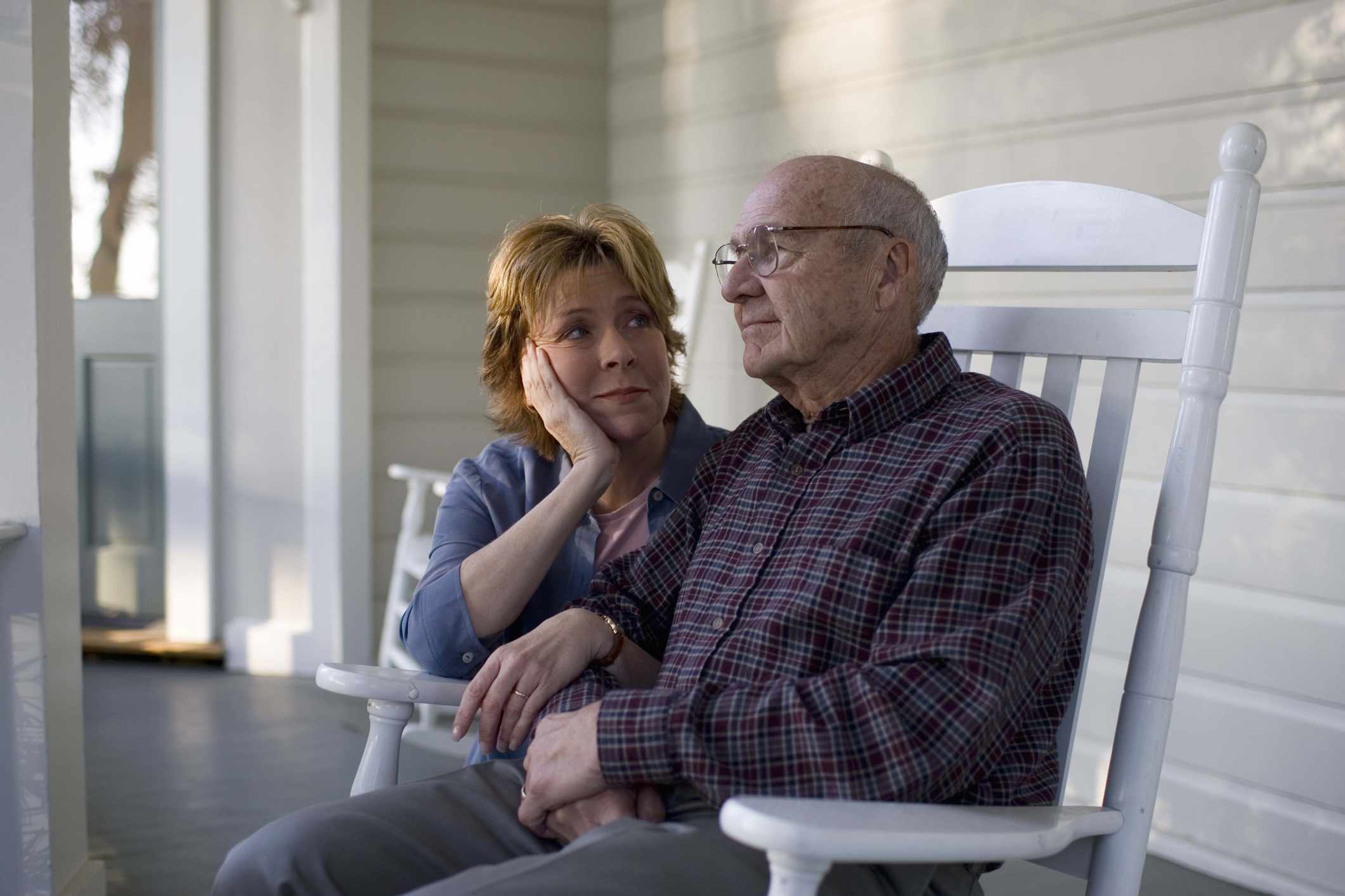 Woman sitting with father