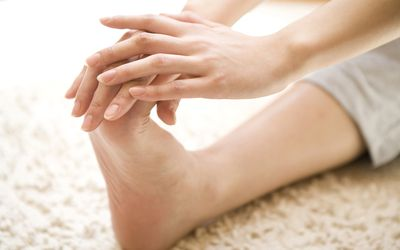 A woman stretching her foot