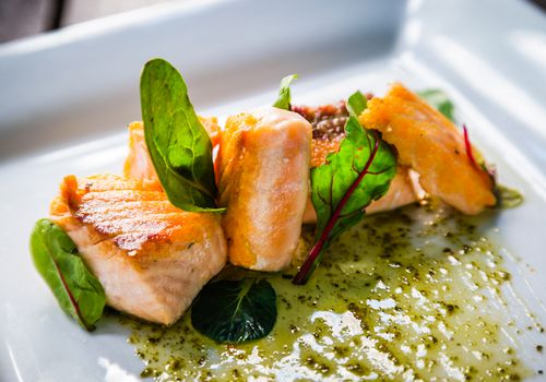 Plate of salmon and arugula