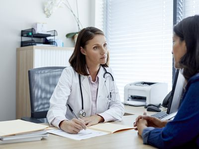 doctor and patient talking in office