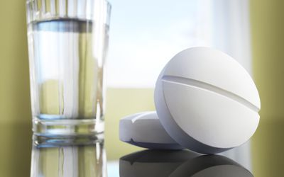 Aspirin and a glass of water