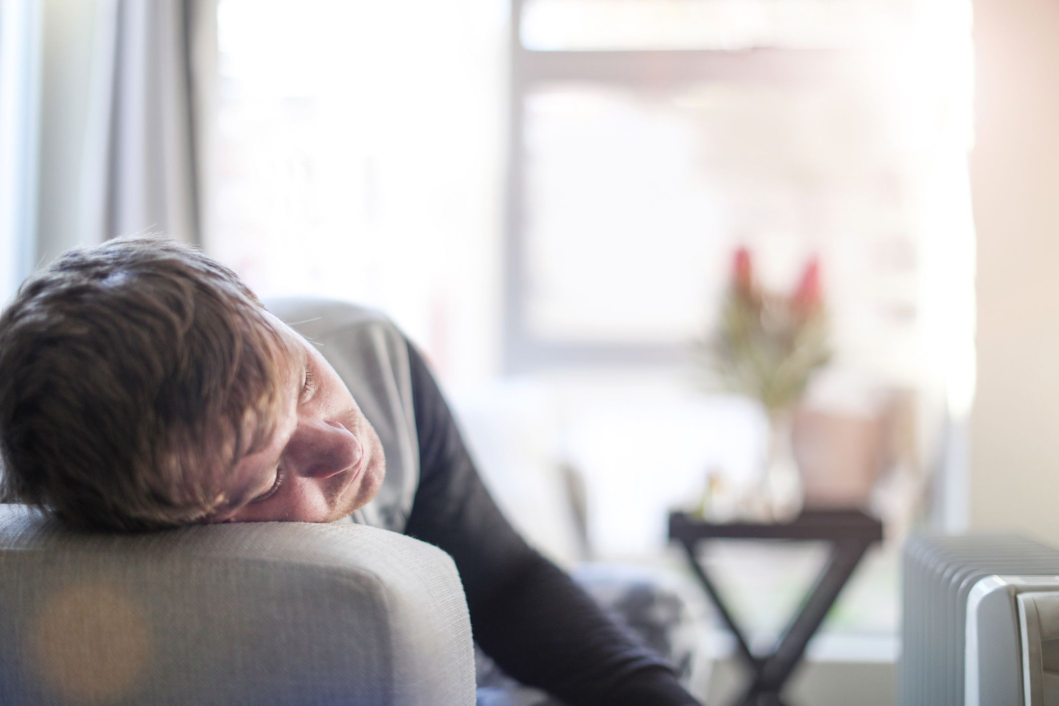 an adult male sick at home