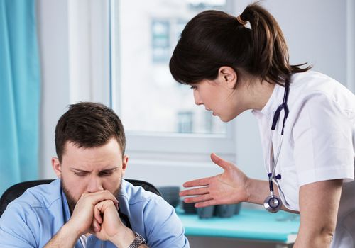 Doctor having a difficult conversation with a patient