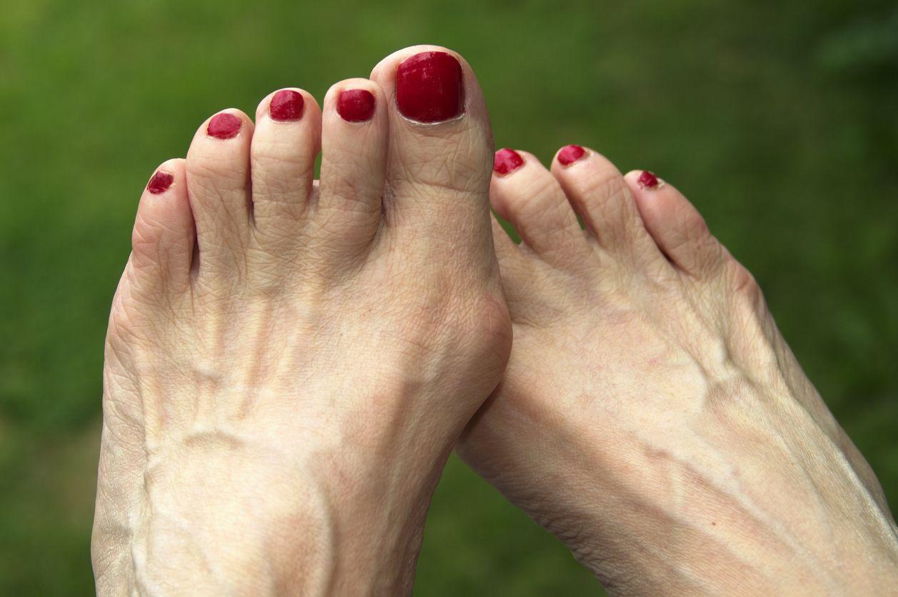 An older woman's feet in the sunlight