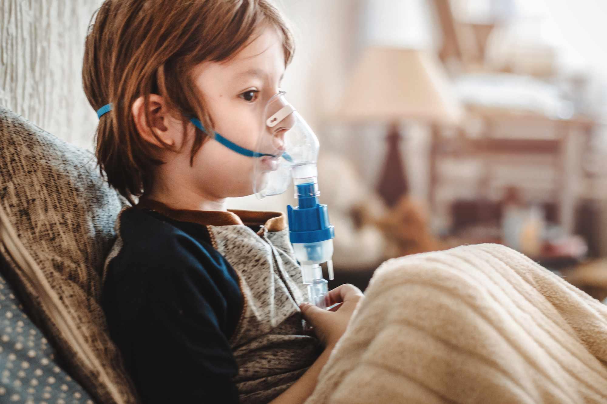 Little boy using a nebulizer