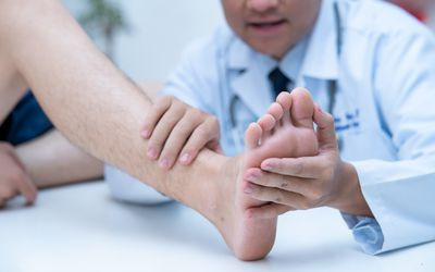 The doctor is examining the patient's feet Doctor dermatologist