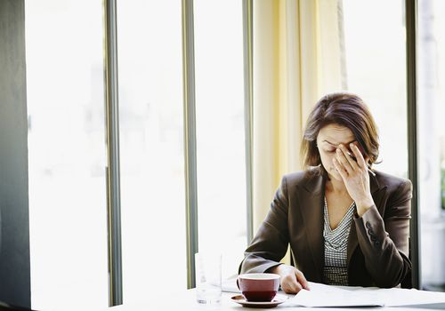 Woman stressed out at work.