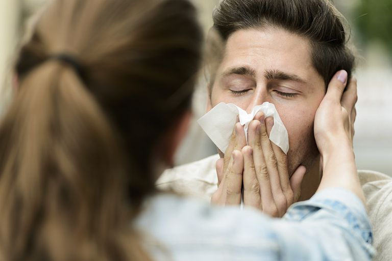 Man worried about runny nose.