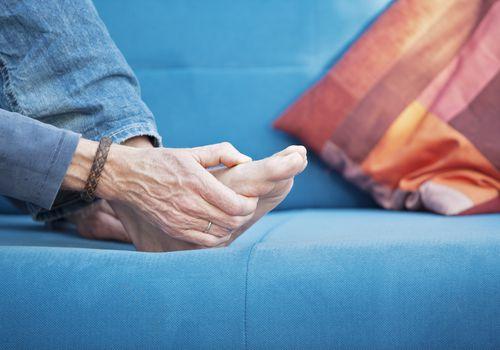 Woman massaging painful foot