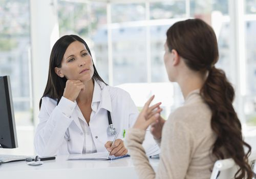 Woman talking to a female doctor in her office