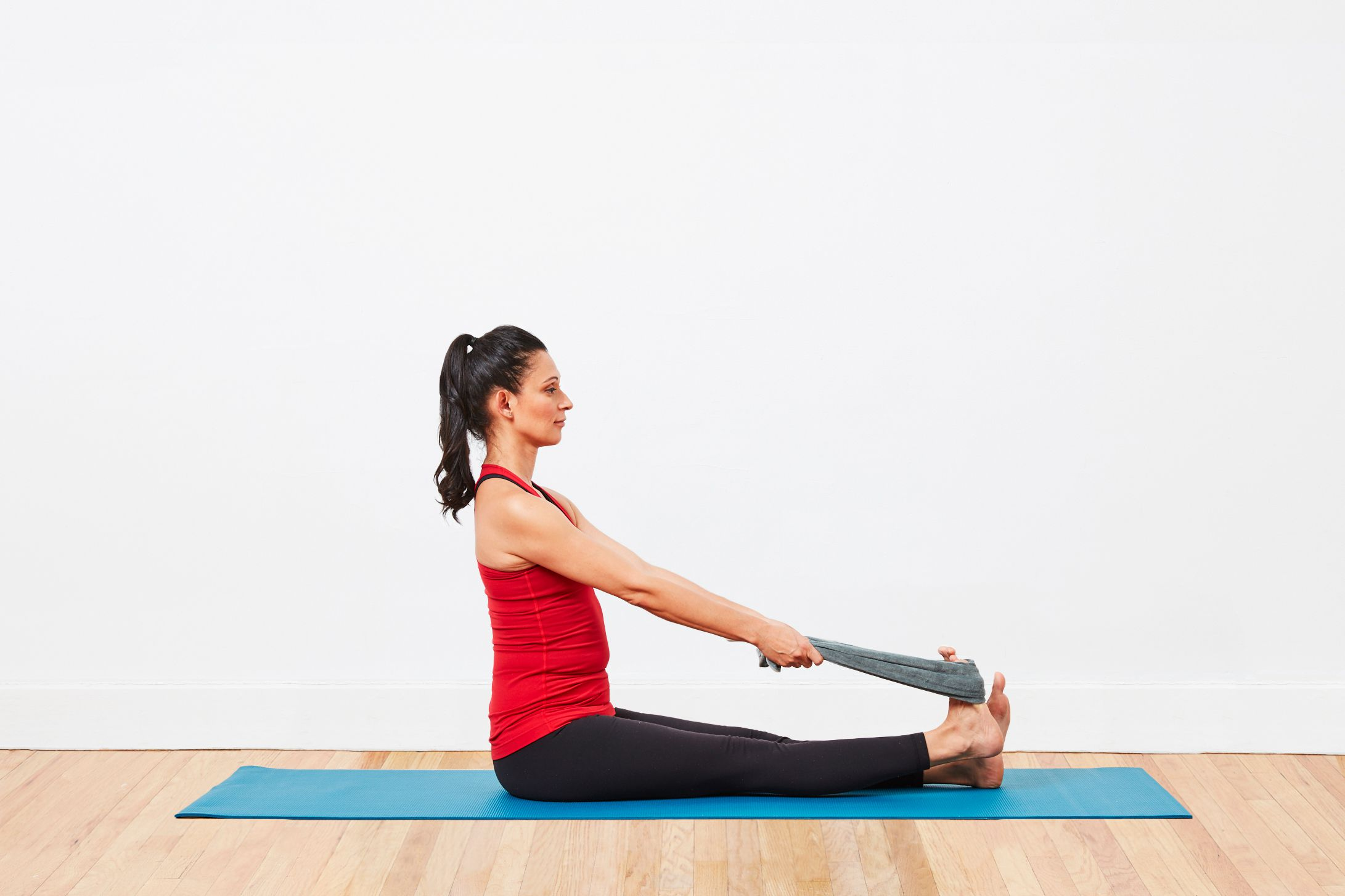woman performing Calf stretch on a yoga mat