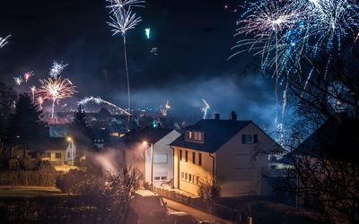 A neighborhood surrounded by fireworks