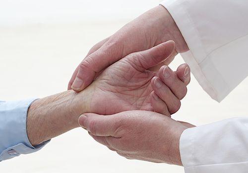 Senior woman having her wrist examineed
