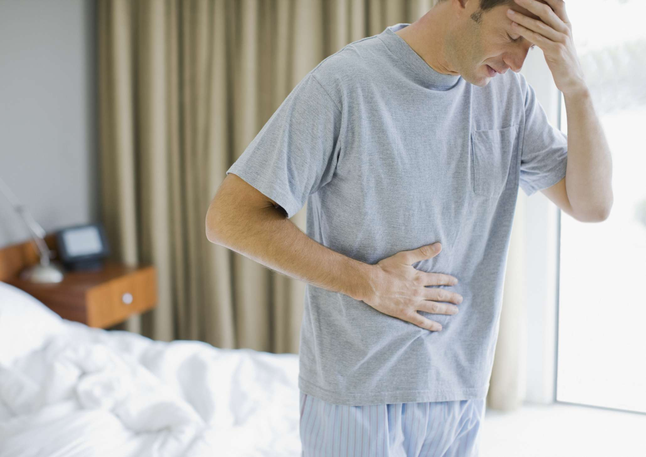 A man holding his stomach in pain
