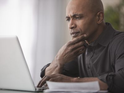 Black man using laptop