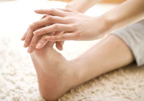 Woman performing foot stretch