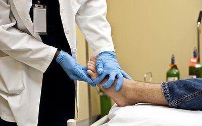 Podiatrist examining patient's foot