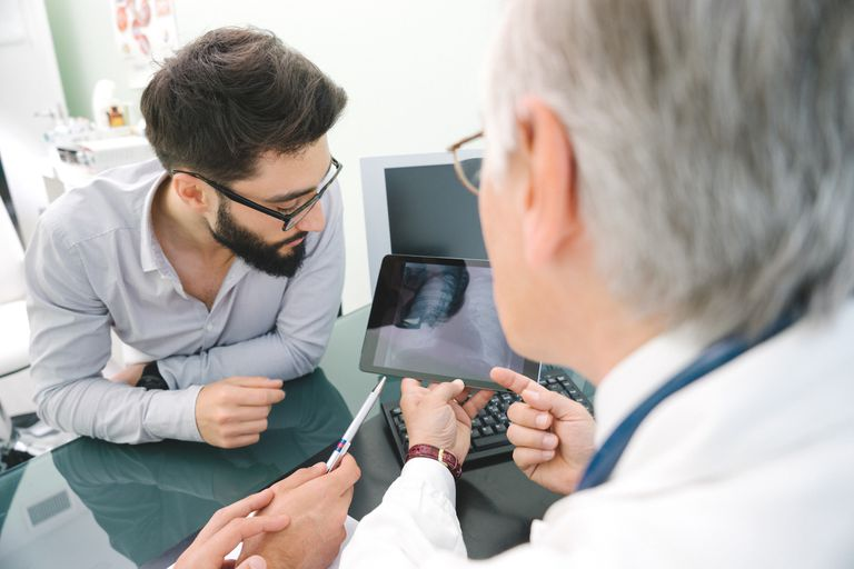 Male doctor using tablet for his diagnosis