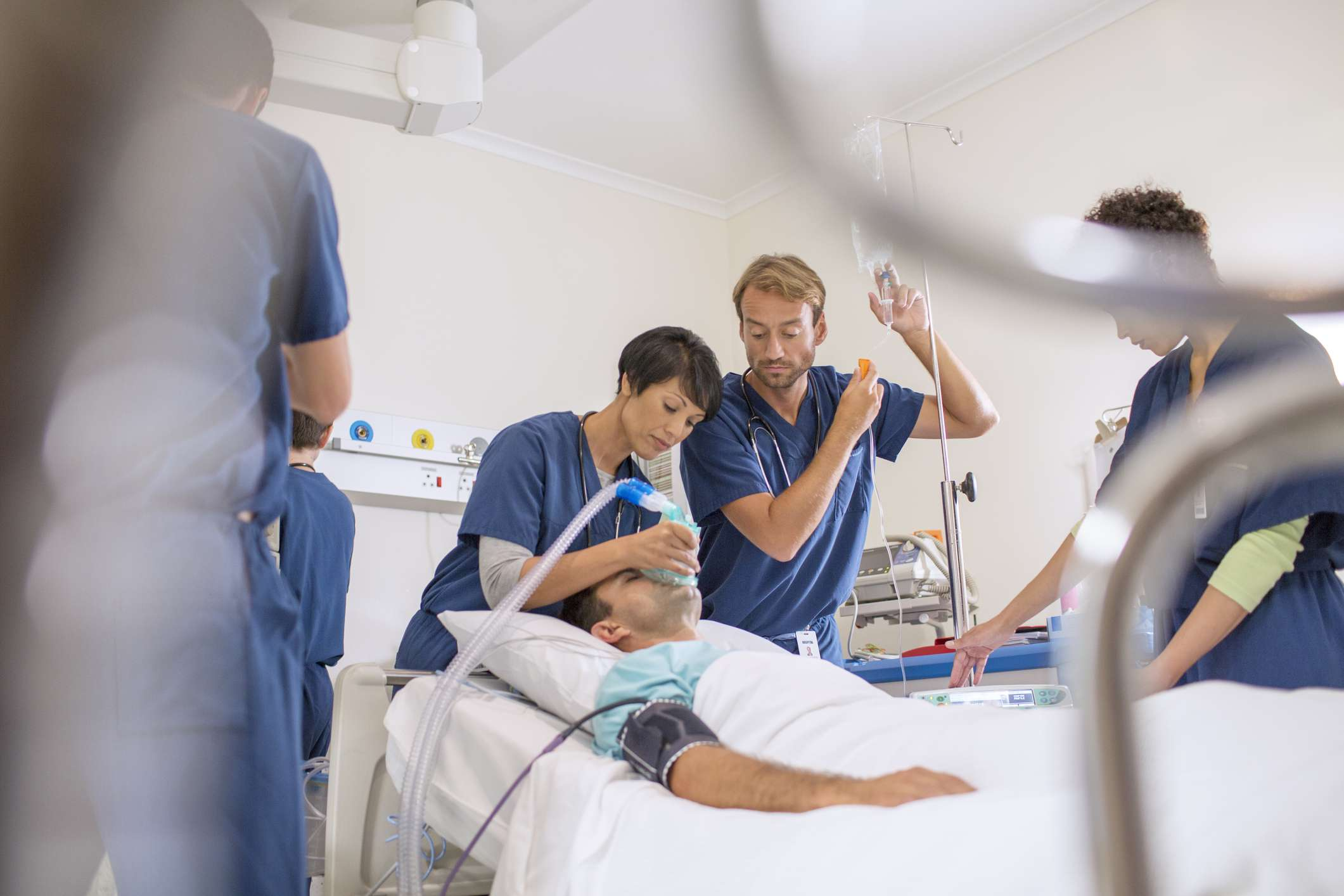 Doctors working on an incapacitated patient