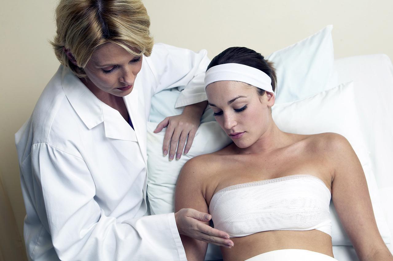 Doctor examining bandaged woman