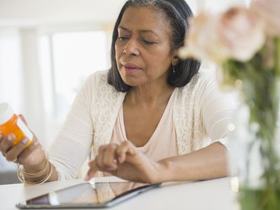 Woman researching medication on her ipad