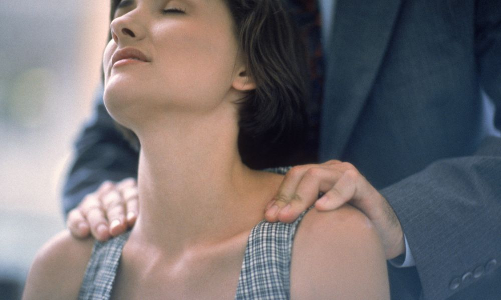 a man massaging a woman's neck