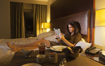 Woman reading digital tablet in bed to stay up late