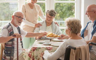 Happy seniors around the table